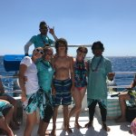 With crew of Dolphins and You