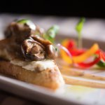 SAUTÉED MUSHROOMS goat cheese crostini, sherry cream, truffle oil