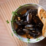 SPICY MUSSELS chorizo, harissa, white wine, cream, grilled garlic crostini