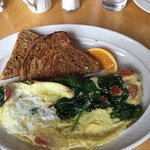 Spinach, tomato, cheese omelet with 3 grain toast (delicious)