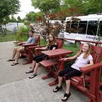 My husband and kids enjoying the chairs outside the office (they also had giant checkers to play