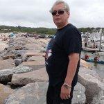 my husband walking along the rock pier