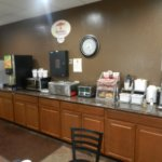 Breakfast buffet, waffle machine is on opposite wall