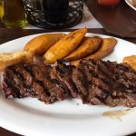 one of the steaks, plantains, and fried cheese