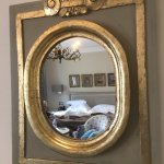 Beautiful decor in the rooms and would love to know where they got this beautiful mirror!