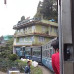 The toy train going around a curve shows the famous monastry