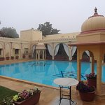 The pavilion lined swimming pool by day