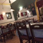 Simple decor like in a traditional Greek Taverna - it's all about the food!! Enjoy!