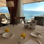 view from the restaurant during breakfast overlooking lake garda