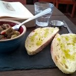 Caponata with homemade bread and olive oil - reading not included