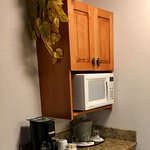 Fridge, microwave and coffee maker in room