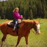 My daughter riding Chrome into the Gallatin forest