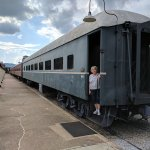 Each railcar room is one half of one of these classic old railroad passenger cars