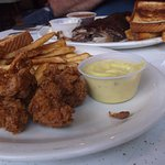 hand breaded chicken strips and ribs in the background