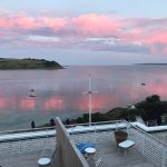 View from room at sunset, Tresanton from the opposite headland, Pinuccia, the hotels yacht, in s