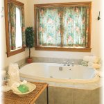 Bathroom area  in Suite #18 showing Jetted Whirlpool Bathtub