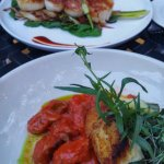 Note the fresh herbs with the seafood dishes