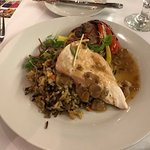 Chicken entree with dirty rice, mushroom gravy, and egg plant