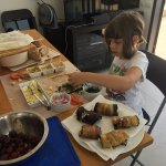 our 6 year old making eggplant rolls