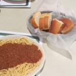 Spaghetti with meat sauce and bread.