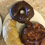 cheese croissant, chocolate coated donut and apple fritter (from left to right)