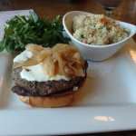 Bison burger with quinoa salad as a side.