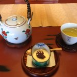 Green tea and sweets on arrival
