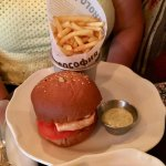 Salmon burger with French fries
