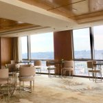25th floor lounge has various shifts of snacks, warm food and drinks almost all from 6 am to mid