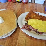 Three egg omelet with corned beef hash and pancakes