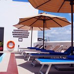 Reclining Chairs by th swimming pool