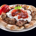 our beef kebaps are topped with slightly warm thick yogurt and warm tomatossauce