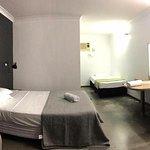 Motel room with bare concrete floors