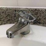 Broken tap in the bathroom