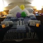 Our lovely room decorated with balloons for my husband's birthday.