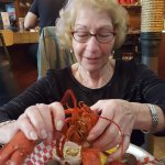My wife enjoying her lobster dinner.