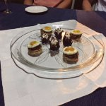 Quail Eggs with Caramelized Onions and Wild hibiscus flower with goat cheese