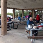 Under the structure picnic tables for 20 to 30 people. By Chato Stewart