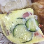 Egg, grilled veggies, and muenster cheese toasted croissant: photo shows veggies are cooked into