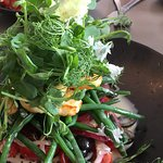 Salad of peashoots & crispy halloumi with olives, tomatoes and green beans.