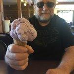 A single scoop cone of Huckleberry Ice Cream!