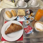 A breakfast tray with hot croissant and rolls.  Forgot to mention in my review the internet spee