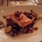 Scottish Salmon on top of a bed of purple potatoes, mushrooms, corn and slab bacon on the salmon