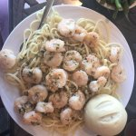 their shrimp scampi served over linguini. such a large amount of food, very tasty.