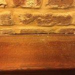 The brick wall ledge.