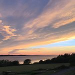 """Day transitioning to evening. Photo taken from a """"water view"""" cottage deck."""