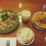 Duck curry on the right, sticky rice on the bottom, That tea on top and basil chicken on the lef