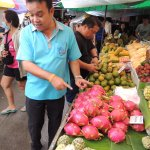 James explaining all the different fruits at the market