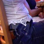 Woman irresponsibly carrying an unholstered gun