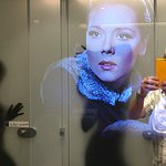 Dame Diana Rigg appears in the mirror in the gent's toilets
